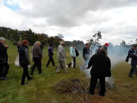 Participants walk through the smoke